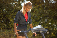 Woman on the treadmill Stock Photography