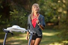 Woman on the treadmill Stock Image