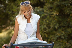 Woman on the treadmill Stock Photo