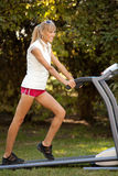 Woman on the treadmill Stock Photos