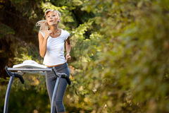 Woman on the treadmill Stock Images