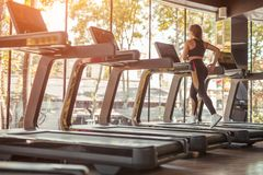 Woman on treadmill Stock Images