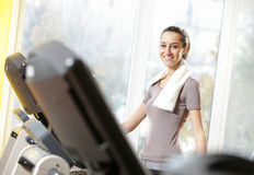 Woman on treadmills Royalty Free Stock Images