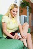 Woman treating foot callosity Royalty Free Stock Photo
