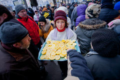 Woman treats demonstrators lemons in the crowd of  Royalty Free Stock Image