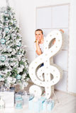 Woman and a treble clef Stock Images