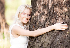 Woman with a tree Royalty Free Stock Photo
