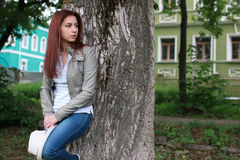 Woman in tree park outdoor. Handsome and attractive person in summer strolls through the city streets stock photos