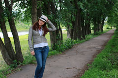Woman in tree park outdoor. Handsome and attractive person in summer strolls through the city streets Royalty Free Stock Photo