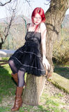 Woman on tree Royalty Free Stock Image