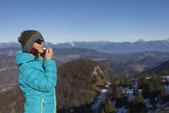 Woman trekker applying balsam lips Stock Photos