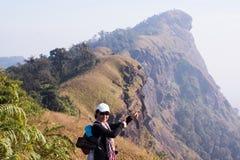 Woman trekker Peak mountain trekking route Royalty Free Stock Photo