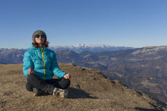 Woman trekker relaxing in mountains Stock Photography