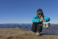 Woman trekker relaxing in mountains Stock Image