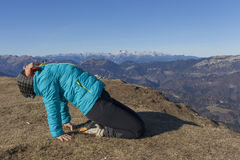 Woman trekker relaxing in mountains Royalty Free Stock Photos