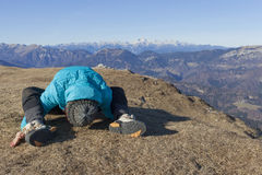 Woman trekker relaxing in mountains Royalty Free Stock Image