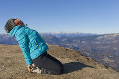 Woman trekker relaxing in mountains Royalty Free Stock Photo