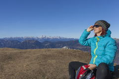 Woman trekker sunbathing in mountains Royalty Free Stock Images