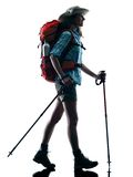 Woman trekker trekking nature silhouette walking Stock Photo