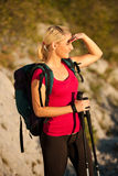 Woman on trekking - Beautiful blonde girl hiking on mountains Stock Images
