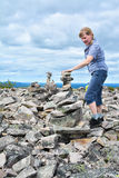 Woman trekking on exteme terrain. On top of rocky mountain Royalty Free Stock Images
