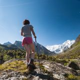 Woman is trekking in highlands of Altai mountains, Russia Stock Photos