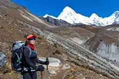 Woman trekking in Himalaya Royalty Free Stock Images