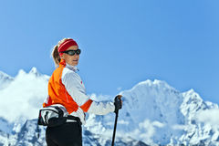 Woman trekking in Himalayas, Royalty Free Stock Photos