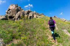 Woman trekking in Macin Mountains in Romania Stock Photos