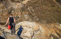 Woman trekking on rocky trail Royalty Free Stock Image