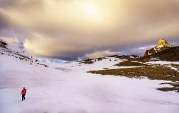Woman trekking in the winter Stock Photo