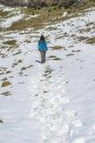 Woman trekking in winter mountains. Royalty Free Stock Photos