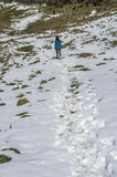 Woman trekking in winter mountains. Royalty Free Stock Photography