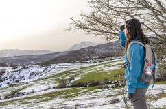 Woman trekking in winter mountains. Stock Photography