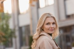 Woman in trench coat outdoors Royalty Free Stock Photos