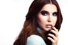 Woman with trendy smokey eyes makeup Stock Photo