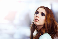 Woman with trendy smokey eyes makeup Royalty Free Stock Image