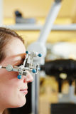 Woman with trial frame at optician Royalty Free Stock Images