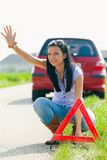 Woman with a triangle which has broken down. Young woman with a triangle which has broken down Royalty Free Stock Images