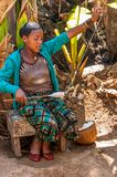 Woman from the tribe Dorze spun cotton . Royalty Free Stock Images