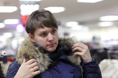 Woman tries on fur coat Stock Photo