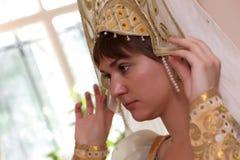 Woman tries on kokoshnik Royalty Free Stock Image