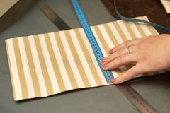 A woman tries on striped material before the reveal royalty free stock image
