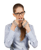 Woman tries to cut the steel chain Royalty Free Stock Photography