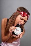 woman tries to eat the clock Royalty Free Stock Photo