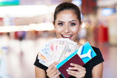 Woman trip abroad. Happy young woman just won a trip abroad royalty free stock photography