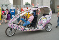 Woman on a trishaw expects the passenger. Moscow Royalty Free Stock Photography