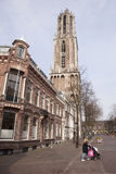 Woman with trolley passes the dom in utrecht Royalty Free Stock Photos