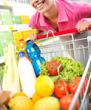Woman with trolley at store Stock Images