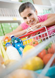 Woman with trolley at store Royalty Free Stock Images